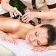 Woman getting stone therapy massage . - Stockfoto