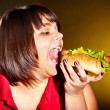 Woman eating hamburger. — Stock Photo