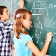 School child writting on blackboard. — Stock Photo #25257231