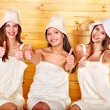 Friend relaxing in sauna. - Stock Photo