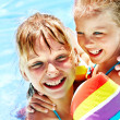 Kids with armbands in swimming pool. — Stock Photo #25257481