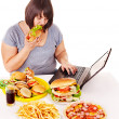 Stock Photo: Woman eating junk food.