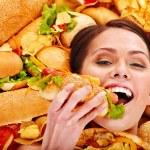 Woman eating hot dog. — Stock Photo #25257519
