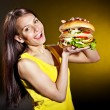 Woman holding hamburger. — Stock Photo #25257605