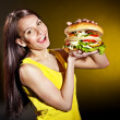 Stock Photo: Woman holding hamburger.