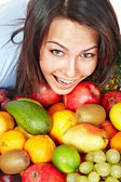 Happy girl with group of fruit. — Stock Photo