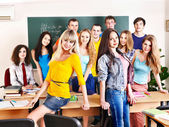 Group student in classroom near blackboard. — Stock Photo