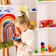 Child drawing on the easel. — Stock Photo #26316423