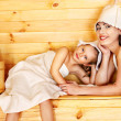 Family with child relaxing at sauna. — Stock Photo #26317699