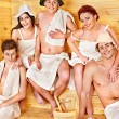 Group in Santa hat at sauna. — Stock Photo