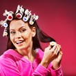 Royalty-Free Stock Photo: Woman wear hair curlers on head.