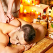 Man getting aroma massage in spa. - Stockfoto