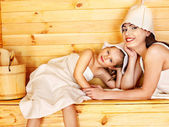 Family with child relaxing at sauna. — Stock Photo