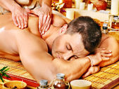 Man getting bamboo massage. — Stock Photo