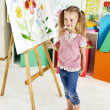 Child painting at easel. — Stock Photo #27608683