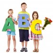 Children holding abc. — Stock Photo #27608013