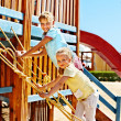 Children move out to slide in playground. — Stock Photo