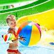 Child on water slide at aquapark. — Stock Photo #27608287