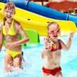 Постер, плакат: Children on water slide at aquapark