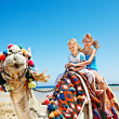 Tourists riding camel on the beach of Egypt. — Stock Photo #27608493