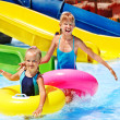 Child on water slide at aquapark. — Stock Photo #27608519