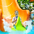 Stock Photo: Child on water slide at aquapark.
