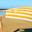 Child running at beach with towel. — Stock Photo #27608779