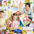 Children with teacher at school. — Stock Photo