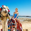 Tourists riding camel on the beach of Egypt. — Stock Photo #27608889