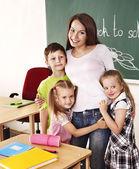 Children in classroom near blackboard. — Stock Photo