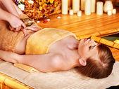 Woman getting massage in bamboo spa. — Foto de Stock