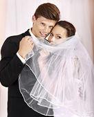 Wedding couple holding flower. — Stock Photo