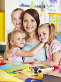 Children with teacher at classroom. — Stock Photo
