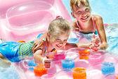 Children swimming on inflatable beach mattress. — Stock Photo