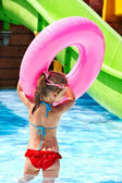 Kid sitting on inflatable ring. — Stock Photo