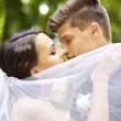 Bride and groom kissing outdoor. — Stock Photo #29031961