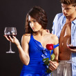 Couple with glass os wine and flower. — Stock Photo #29031067