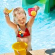 Child with bucket in swimming pool. — Stock Photo #29031087