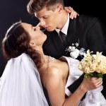 Groom embracing bride . — Stock Photo