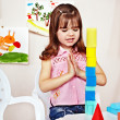 Stock Photo: Child with construction set in play room.