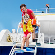 Happy family with child on yacht. — Stock Photo