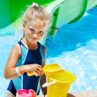 Child with bucket in swimming pool. — Stock Photo #29031237