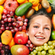 Happy girl in group of fruit. — Stock Photo