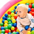 Child in colored ball. — Stock Photo #29031301
