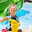 Child with bucket in swimming pool. — Stock Photo #29031345