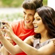Stock Photo: Couple with camera take pictures