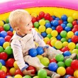 Child in colored ball. — Stock Photo #29031435