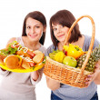 Women choosing between fruit and hamburger. — Stock Photo #29031459