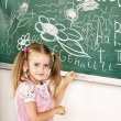 School child writing on black board. — Stock Photo