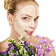 Stock Photo: Woman with facial mask.